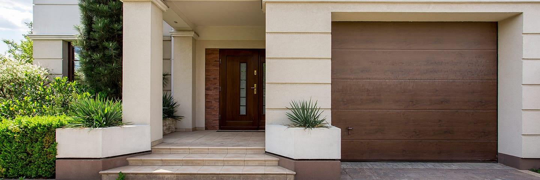Beautiful home with wood garage door